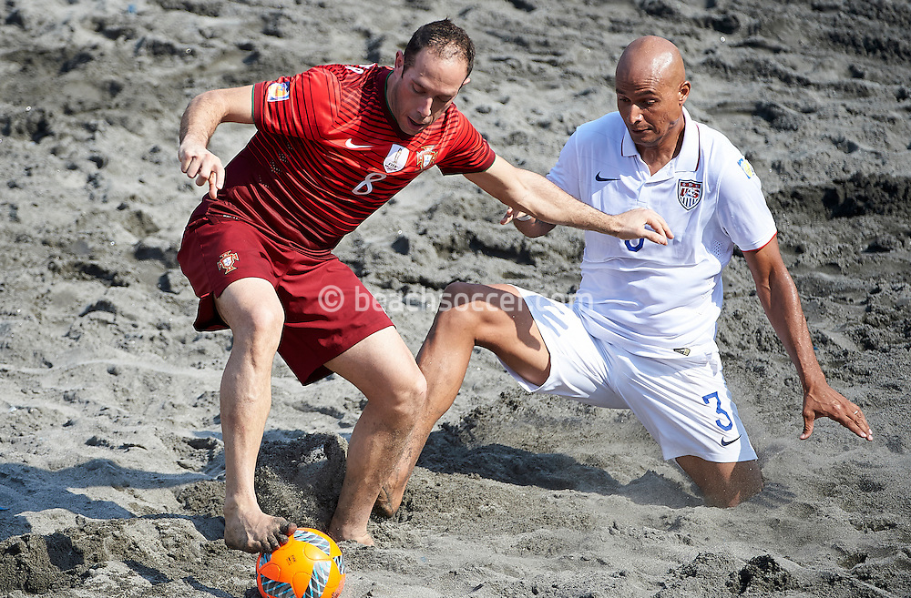 Jose Maria of Portugal looks to keep the ball away from USA's Garcia at the Copa Pilsener 2016.