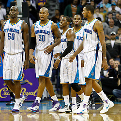 January 24,  2011; New Orleans, LA, USA; Hornets player Emeka Okafor (50), David West (30), Chris Paul (3), Marcus Thornton (5) and Trevor Ariza (1) walk to the bench during in timeout in the final seconds of the fourth quarter in a win over the Oklahoma City Thunder at the New Orleans Arena. The Hornets defeated the Thunder 91-89. Mandatory Credit: Derick E. Hingle