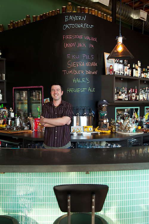 Beaker and Flask, a restaurant and bar in SE Portland, Oregon, serves up specialty cocktails.  Bartender and Mixologist Kevin Ludwig behind the bar.