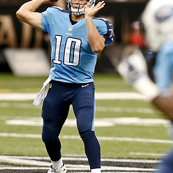 Aug 15, 2014; New Orleans, LA, USA; Tennessee Titans quarterback Jake Locker (10) throws against the New Orleans Saints during first quarter of a preseason game at Mercedes-Benz Superdome. Mandatory Credit: Derick E. Hingle-USA TODAY Sports