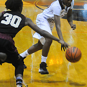 New Hanover's Taylor Perkins drives around Ashley's Chyna Cotten Friday December 19, 2014 at New Hanover High School in Wilmington, N.C. (Jason A. Frizzelle)
