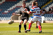 Bradford Bulls stand off Jordan Lilley (28) kicks the ball through during the Kingstone Press Championship match between Rochdale Hornets and Bradford Bulls at Spotland, Rochdale, England on 18 June 2017. Photo by Simon Davies.