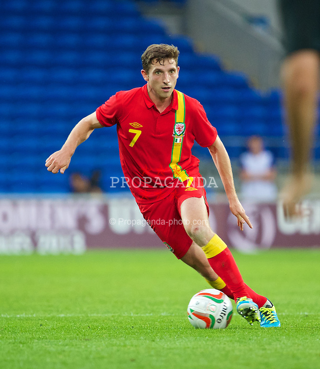 CARDIFF, WALES - Wednesday, August 14, 2013: Wales' Joe Allen in action against Republic of Ireland during an International Friendly at the Cardiff City Stadium. (Pic by David Rawcliffe/Propaganda)