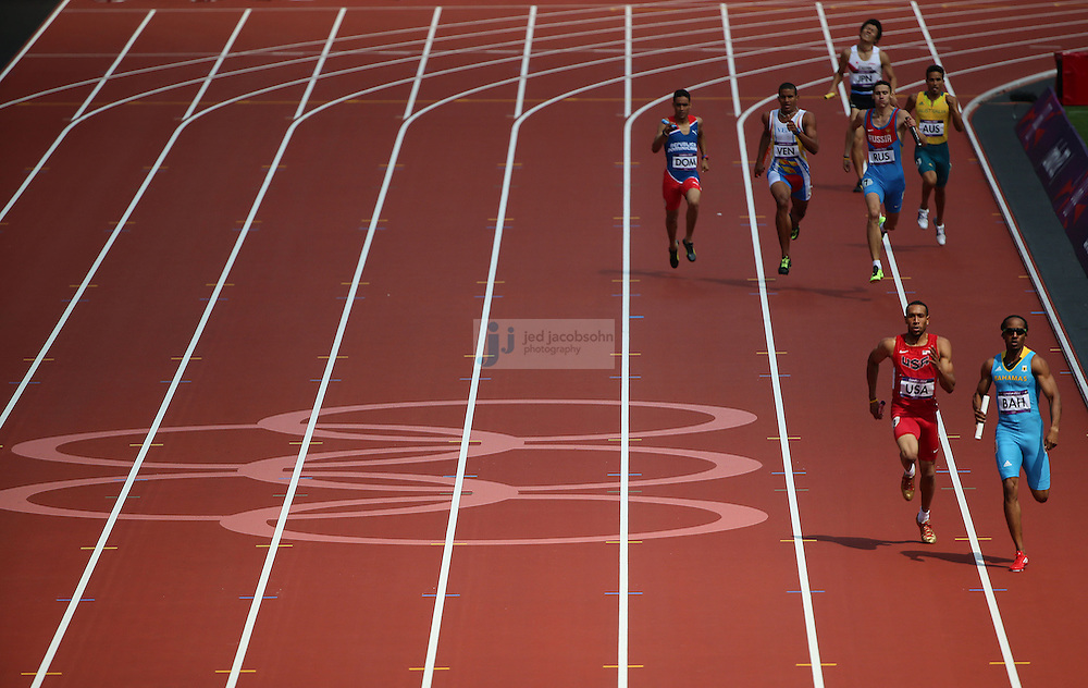 The second heat runs down the back stretch during the 4X100 relay during track and field at the Olympic Stadium during day 13 of the London Olympic Games in London, England, United Kingdom on August 9, 2012..(Jed Jacobsohn/for The New York Times)..