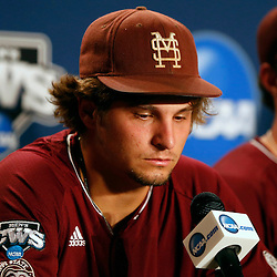 Jun 25, 2013; Omaha, NE, USA; Mississippi State Bulldogs pitcher Kendall Graveman (49) addresses the media in a press conference after game 2 of the College World Series finals against the UCLA Bruins at TD Ameritrade Park. UCLA defeated Mississippi State 8-0. Mandatory Credit: Derick E. Hingle-USA TODAY Sports