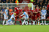 Thomas Ince of Huddersfield Town sees his free kick at goal go over the wall and over the bar. Premier League match, Liverpool v Huddersfield Town at the Anfield stadium in Liverpool, Merseyside on Saturday 28th October 2017.<br /> pic by Chris Stading, Andrew Orchard sports photography.
