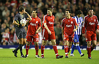 Photo: Paul Greenwood/Sportsbeat Images.<br />Liverpool v Porto. UEFA Champions League. 28/11/2007.<br />Liverpool's Javier Mascherano, second left,  questions referee Roberto Rosetti as the players leve the field