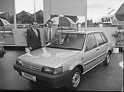 """Nissan Launches New """"Sunny""""..1986..21.08.1986..08.21.1986..21st August 1986..Nissan Ireland launched the all new integrated Sunny range on to the Irish market.The launch was the European premiere of this model and marked a significant second phase in the rationalisation of the Nissan Product range. The first Phase was the launch of the Bluebird range in February of this year. The Launch took place at Nissan House, Naas Road Dublin...Pictured at the Nissan """"Sunny"""" launch were Mr Michael Murphy,Sales Director,Nissan Ireland and Mr Tony Kelly,Deputy Managing Director,Nissan Ireland."""