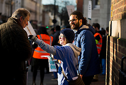 © Licensed to London News Pictures. 12/01/2016. London, UK. Junior doctors hand out stickers on the Picket line at St Mary's Hospital in Paddington, West London. Thousand of doctors across England have gone on strike in a dispute with the government over a new contract. Photo credit: Ben Cawthra/LNP