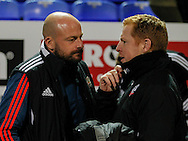 Outgoing  Brentford Head Coach Lee Carsley chats with Bolton Wanderers Manager Neil Lennon prior to the Sky Bet Championship match between Bolton Wanderers and Brentford at the Macron Stadium, Bolton<br /> Picture by Mark D Fuller/Focus Images Ltd +44 7774 216216<br /> 30/11/2015