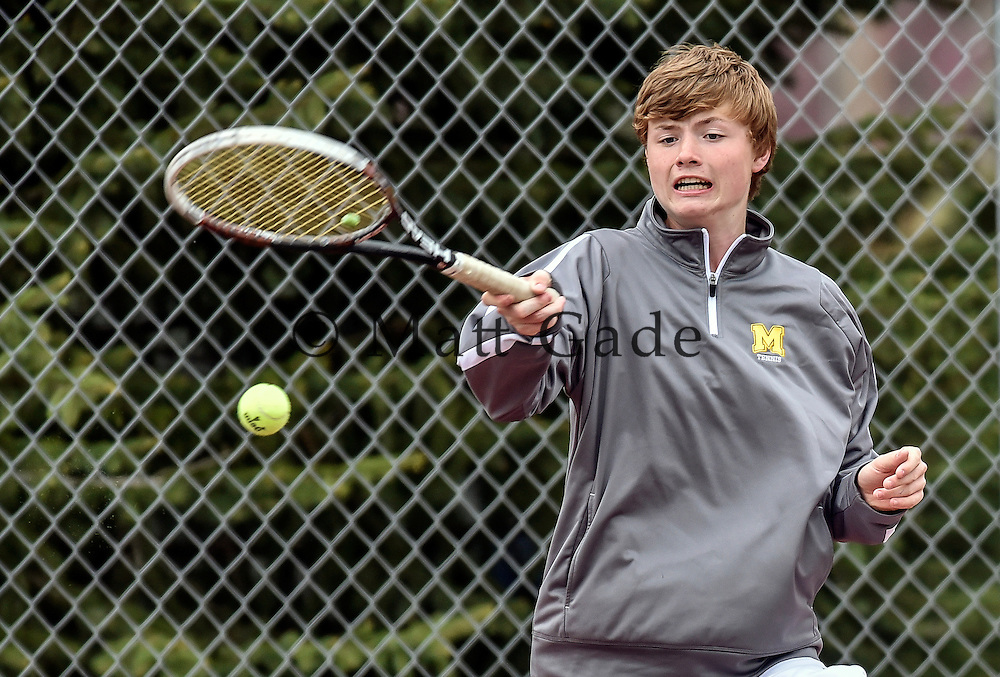 Mitchell's Jared Suelflow returns a shot during No. 3 doubles action with Baley Miller during a dual against Brookings on Tuesday at Hitchcock Park in Mitchell. (Matt Gade/Republic)