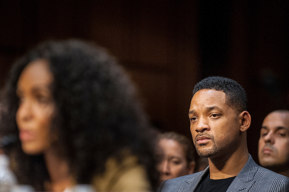 """Actor WILL SMITH looks on as his wife, JADA PINKETT SMITH, actress and advocate for Don't Sell Bodies, testifies before the Senate Foreign Relations Committee about """"The Next Ten Years in the Fight Against Human Trafficking: Attacking the Problem with the Right Tools"""" on Capitol Hill on Tuesday."""