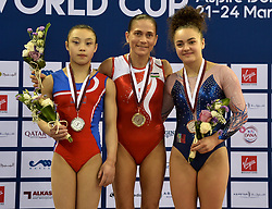 DOHA, March 24, 2018  Gold medalist Oksana Chusovitina (C) of Uzbekistan poses with silver medalist Rye Yong Pyon (L) of the Democratic People's Republic of Korea (DPRK) and bronze medalist Coline Devillard of France during the awarding ceremony for the Women's Vault final at the 11th FIG Artistic Gymnastics World Cup in Doha, Qatar, on March 23, 2018.  wll) (Credit Image: © Nikku/Xinhua via ZUMA Wire)