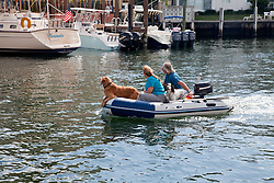 Ft. Lauderdale, Florida:  Sightseers cruise the Intracoastal Canal and New River, both of which parallel the inland side of the city's prime beach real estate.
