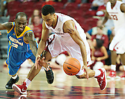 FAYETTEVILLE, AR - NOVEMBER 13:  Jabril Durham #4 of the Arkansas Razorbacks steals the ball from Adrian Rodgers #2 of the Southern University Jaguars at Bud Walton Arena on November 13, 2015 in Fayetteville, Arkansas.  The Razorbacks defeated the Jaguars 86-68.  (Photo by Wesley Hitt/Getty Images) *** Local Caption *** Jabril Durham; Adrian Rodgers