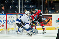 KELOWNA, CANADA - DECEMBER 7: Leif Mattson #28 of the Kelowna Rockets looks for the pass as Griffen Outhouse #30 defends the net while Jameson Murray #6 of the Victoria Royals tries to block the shot during first period on December 7, 2018 at Prospera Place in Kelowna, British Columbia, Canada.  (Photo by Marissa Baecker/Shoot the Breeze)