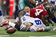 DALLAS, TX - SEPTEMBER 23:  Tony Romo #9 of the Dallas Cowboys fumbles the ball after being hit by Michael Bennett #71 of the Tampa Bay Buccaneers at Cowboys Stadium on September 23, 2012 in Dallas, Texas.  The Cowboys defeated the Buccaneers 16-10.  (Photo by Wesley Hitt/Getty Images) *** Local Caption *** Tony Romo; Michael Bennett