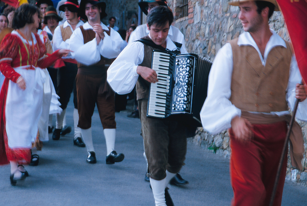 Europe, Italy, Tuscany, teenagers walking in procession during festival