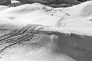 Ski tourers are climbing up to mount Glatten, Muotathal, Schwyz, Switzerland