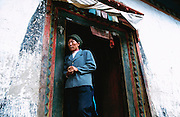 September 2003 - Yubeng, China - A Tibetan women leaves a small monastery after praying.<br /> Photo credit: Luke Duggleby