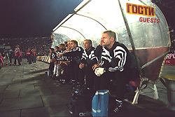 VLADIKAVKAZ, RUSSIA - Tuesday, September 12, 1995: Liverpool's manager Roy Evans on the bench against FC Alania Spartak Vladikavkaz with his back-room staff Doug Livermore and physio Mark Leather during the UEFA Cup 1st Round 1st Leg match at Republican Spartak Stadium. (Photo by David Rawcliffe/Propaganda)