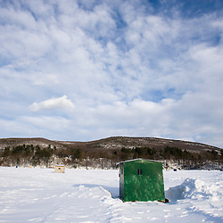 Ice fishing shacks on the West River in Brattleboro, Vermont.  Bob House.