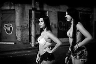 "Lara Santos, Karol. The two transsexuals wait for a client to pass by. In Campinas the dress code requires showing more body, unlike what happens in São Paulo. To ""meet"" clients in this street, they must pay a commission to a woman who runs it."