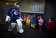 A group of pre-school children watch as Vancouver Canucks goalie Roberto Luongo leaves the dressing room during a practice in Vancouver, BC. ( 2013)