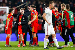 Joe Morrell celebrates with Daniel James and Tom Lockyer of Wales after Wales win 2-0 to secure their qualification for Euro 2020 - Rogan/JMP - 19/11/2019 - FOOTBALL - Cardiff City Stadium - Cardiff, Wales - Wales v Hungary - UEFA Euro 2020 Qualifiers.
