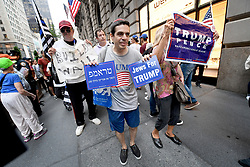 Pro-Trump supporters march across the street from Anti-Trump protestors near Trump Tower during President Donald Trump's first stay in New York City since taking office, New York, NY, on August 15, 2017. (Photo by Anthony Behar)