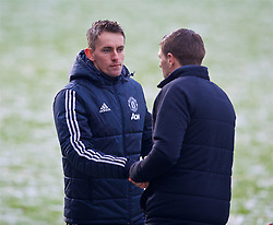MANCHESTER, ENGLAND - Saturday, December 9, 2017: Manchester United's head coach Kieran McKenna shakes hands with Liverpool's Under-18 manager Steven Gerrard after an Under-18 FA Premier League match between Manchester United and Liverpool FC at the Cliff Training Ground. (Pic by David Rawcliffe/Propaganda)