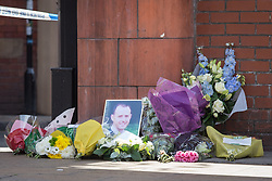 © Licensed to London News Pictures . 14/07/2013 . Manchester , UK . FLowers and tributes left at the  scene where a fire fighter, identified as Stephen Hunt, died while tackling a fire in a store-room of Paul's Hair World in Oldham Street, Manchester. Two 15-year-old girls arrested on suspicion of manslaughter. Photo credit : Joel Goodman/LNP
