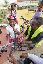 Bicycle maintenance workshop for children, Hale Village, London Borough of Haringey