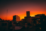 urban Cityscape with a red sunset background (Photographed in Tel Aviv, Israel. City hall in the centre)