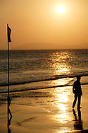 Field Trip with the kids from Masion Chance out of Saigon to the beach at sunset and a solo man walking on the beach
