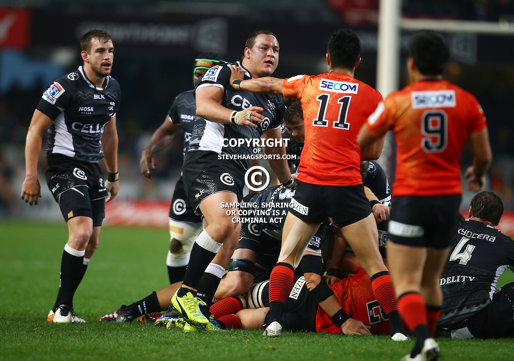 DURBAN, SOUTH AFRICA - JULY 15: Yasutaka Sasakura of the Sunwolves hits Coenie Oosthuizen of the Cell C Sharks off the ball during the Super Rugby match between the Cell C Sharks and Sunwolves at Growthpoint Kings Park on July 15, 2016 in Durban, South Africa. (Photo by Steve Haag/Gallo Images)