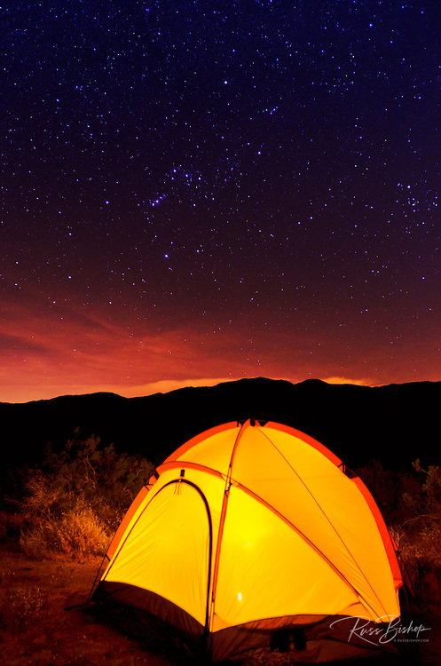 Yellow dome tent glowing under the Milky Way, Anza-Borrego Desert State Park, California USA