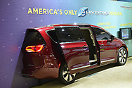 Manhattan, New York, USA. April 12, 2017. Right half of red Chrysler eHybrid Minivan is displayed at the New York International Auto Show, NYIAS, at the Javits Center. Displays states it's America's only EHYBRID Minivan.