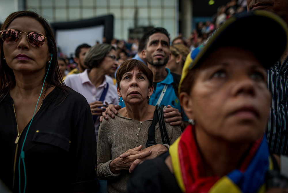 CARACAS, VENEZUELA - MAY 17, 2017: Political opposition supporters listen as leaders make a speech during a vigil to honor the memory of anti-government protesters killed during recent clashes.  PHOTO: Meridith Kohut
