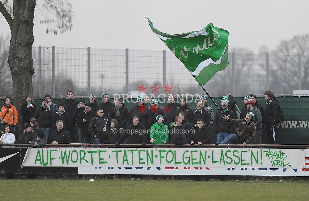 """26.02.2011, Trainingsgelaende Werder Bremen, Bremen, GER, 1.FBL, Training Werder Bremen, im Bild Fans haben ein Plakat aufgehaengt mit der Aufschrift """"Auf Worte Taten folgen lassen""""   EXPA Pictures © 2011, PhotoCredit: EXPA/ nph/  Frisch       ****** out of GER / SWE / CRO  / BEL ******"""