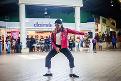 """Invincible: A Glorious Tribute to the King of Pop""  Dancers perform a dance workshop with children at Tutu Park Mall.  Dancers of ""Invincible"", a Michael Jackson tribute, will perform at Reichhold Center for the Arts Saturday at 7pm.  © Aisha-Zakiya Boyd"