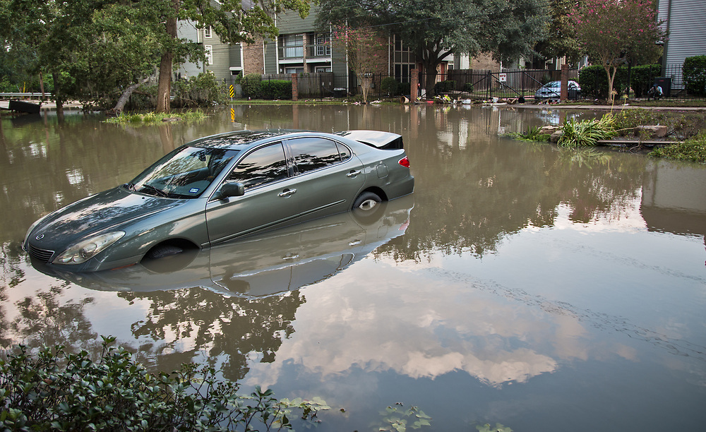 Days after Hurricane Harvey first made landfall in Texas, a flooded car infront of a subivision on Memorial Road in Houston, Texas remained underwater. The flooding in this part of Houton was impacted by Harvey's rainstomr and  water released from the  Addicks Dam.  When the Addicks Reservoir started to over flow the U.S. Army Corps of Engineers began releasing water from the Addicks Dam, which had already started to overflow.