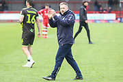 Forest Green Rovers assistant manager, Scott Lindsey applauds the fans at the end of the match during the EFL Sky Bet League 2 match between Crawley Town and Forest Green Rovers at The People's Pension Stadium, Crawley, England on 6 April 2019.
