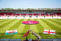 LLANELLI, WALES - Thursday, August 22, 2013: Wales walk out to take on England before the Group A match of the UEFA Women's Under-19 Championship Wales 2013 tournament at Parc y Scarlets. (Pic by David Rawcliffe/Propaganda)