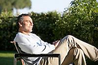 Man Relaxing in Garden