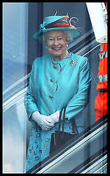 Image licensed to i-Images Picture Agency. 17/07/2014. Reading, United Kingdom. The Queen travels on an escalator after opening Reading Railway Station in Berkshire, United Kingdom, to mark a £895 million (pounds sterling)  re-development of the station.  Picture by Stephen Lock / i-Images