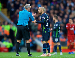 LIVERPOOL, ENGLAND - Sunday, October 7, 2018: Manchester City's David Silva speaks with referee Martin Atkinson during the FA Premier League match between Liverpool FC and Manchester City FC at Anfield. (Pic by David Rawcliffe/Propaganda)