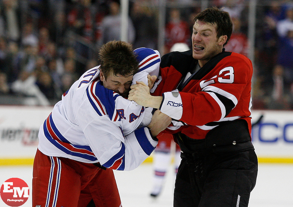 Feb 9, 2009; Newark, NJ, USA; New Jersey Devils right wing David Clarkson (23) and New York Rangers defenseman Erik Reitz (4) fight during the first period at the Prudential Center.