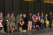 Vietnam veterans attend a Veterans Day ceremony at the Vietnam Veterans Memorial November 11, 1996 in Washington, DC.