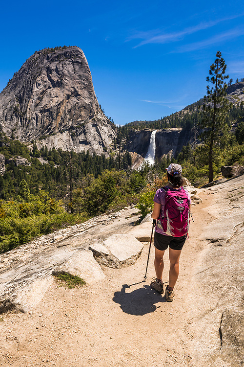 Hiker on the John Muir Trail below Nevada Fall, Yosemite National Park, California USA